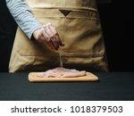 woman hand sprinkle raw chicken ... | Shutterstock . vector #1018379503