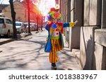 little boy dressed as a clown. | Shutterstock . vector #1018383967