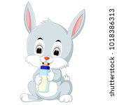 cartoon cute bunny holding...   Shutterstock . vector #1018386313