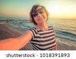 stylish attractive mature woman ...   Shutterstock . vector #1018391893