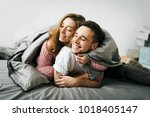 cheerful couple under the... | Shutterstock . vector #1018405147