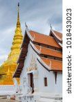 Small photo of golden pagoda and white ubosot ,Wat Phra That Chae Haeng temple, Pha Sing, Mueang Nan District, Nan, Thailand