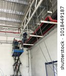 Small photo of View from the bottom, Mechanical Engineer Install a hose for the fire alarm system.