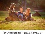 children eating cookies in the... | Shutterstock . vector #1018459633