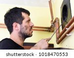 chimney sweep cleaning. man... | Shutterstock . vector #1018470553