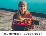 beautiful tourist girl holding... | Shutterstock . vector #1018478917