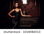portrait of an attractive young ... | Shutterstock . vector #1018486513