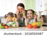 happy family mom and kids... | Shutterstock . vector #1018503487