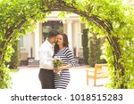 couple in love are facing each... | Shutterstock . vector #1018515283
