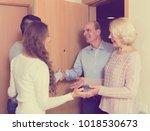 happy  couple meeting mature... | Shutterstock . vector #1018530673