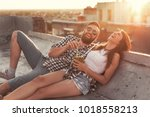 young couple in love drinking a ... | Shutterstock . vector #1018558213