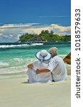 elderly couple rest at tropical ... | Shutterstock . vector #1018579633