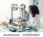 engineering students using a 3d ... | Shutterstock . vector #1018594663