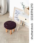 a modern stool with a knitted...   Shutterstock . vector #1018596193
