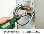 electrician at work  | Shutterstock . vector #1018606267