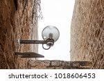 lamp on street of stone old...   Shutterstock . vector #1018606453