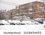 cars after snowfall | Shutterstock . vector #1018654453