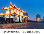 ancient city wall at night  xi... | Shutterstock . vector #1018662493