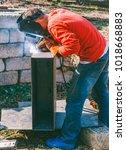 a welder puts the seam on the... | Shutterstock . vector #1018668883
