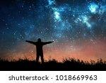 man watching the stars in night ... | Shutterstock . vector #1018669963