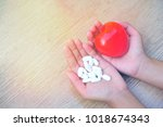 drugs and red heart in hands... | Shutterstock . vector #1018674343