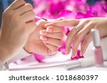 manicure specialist painting... | Shutterstock . vector #1018680397