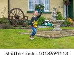 editorial use only  small boy...   Shutterstock . vector #1018694113