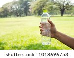 hand holding drinking water...   Shutterstock . vector #1018696753