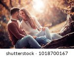 happy young couple having fun... | Shutterstock . vector #1018700167