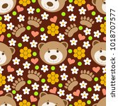 cute bears and paws on brown... | Shutterstock .eps vector #1018707577