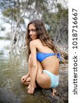sexy girl in bikini on a tiny... | Shutterstock . vector #1018716667