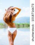 beautiful girl in bikini... | Shutterstock . vector #1018716673