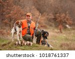 hunter with two hunting dogs  a ...   Shutterstock . vector #1018761337