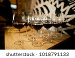 glasses of wine on the table in ... | Shutterstock . vector #1018791133