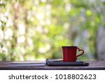 red cup and notebooks at outdoor | Shutterstock . vector #1018802623