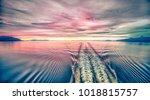 sunset over alaska fjords on a... | Shutterstock . vector #1018815757