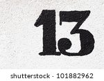 number thirteen painted on the wall - stock photo