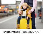 cute little boy and his father... | Shutterstock . vector #1018829773