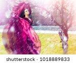 sensual woman in violet dress... | Shutterstock . vector #1018889833