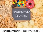 unhealthy snacks on a table ... | Shutterstock . vector #1018928083