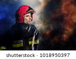 firefighter during action in... | Shutterstock . vector #1018950397