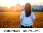 young woman admires the sunset  ... | Shutterstock . vector #1018963393