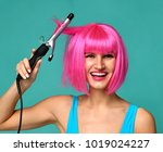 happy woman in pink wig with... | Shutterstock . vector #1019024227