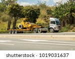 Small photo of Phetchabun, THAILAND – January 31, 2018 Lowboy semi-trailer carrying vibratory soil compactor on the Asian highway