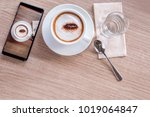 top view of cup of coffee and... | Shutterstock . vector #1019064847