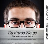 Business News. Young adult looking for daily news. - stock photo