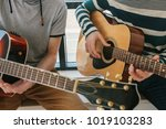 learning to play the guitar.... | Shutterstock . vector #1019103283