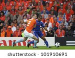 BERN, SWITZERLAND - JUNE 13:  Andre Ooijer of Holland (L) defends against Florent Malouda of France (R) during a Euro 2008 match June 13, 2008 in Bern, Switzerland.  Editorial use only. - stock photo