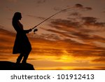 A Woman Is Fishing In The...