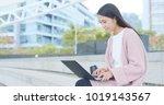 woman using notebook computer...   Shutterstock . vector #1019143567